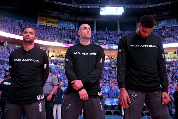 San Antonio Spurs' Tony Parker (from left), Manu Ginobili, and Tim Duncan stand during the national anthem before  Game 6 in the Western Conference semifinals against the Oklahoma City Thunder Thursday May 12, 2016 at Chesapeake Energy Arena in Oklahoma City, Oklahoma.