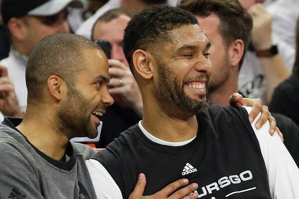 Tony Parker and Tim Duncan share a laugh on the bench in the fourth quarter as the Spurs host the Thunder in game 1 of second round NBA playoff action at the AT&T Center on April 230, 2016.