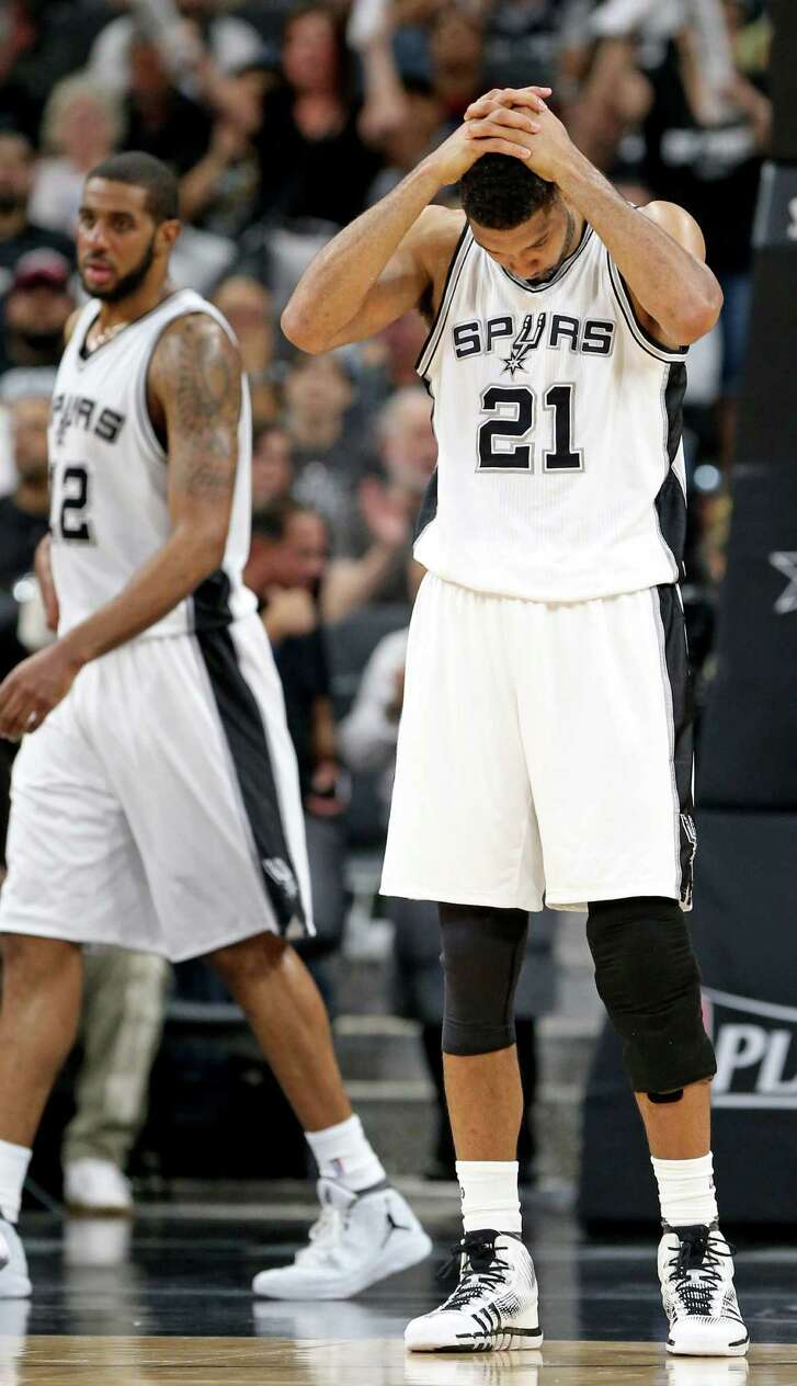 San Antonio Spurs' Tim Duncan puts his hands on his head during second half action of Game 5 in the Western Conference semifinals against the Oklahoma City Thunder Tuesday May 10, 2016 at the AT&T Center. The Thunder won 95-91.