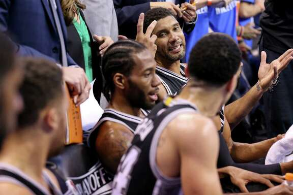 San Antonio Spurs' Tim Duncan talks with teammates on the bench during a timeout in second half action of Game 6 in the Western Conference semifinals against the Oklahoma City Thunder  Thursday May 12, 2016 at Chesapeake Energy Arena in Oklahoma City, Oklahoma. The Thunder won 113-99.