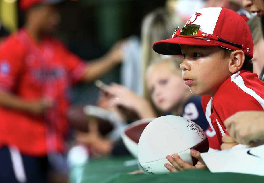 Daniel O'Briant, 8, waits for autographs before the 4th annual J. J. Watt Charity Classic at Minute Maid Park Saturday, May 14, 2016, in Houston. Photo: Jon Shapley, Houston Chronicle / © 2015  Houston Chronicle