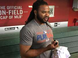 Johnny Cueto of the San Francisco Giants shows off his World Series ring after receiving it from a Kansas City Royals representative at Chase Field in Phoenix on May 14, 2016.