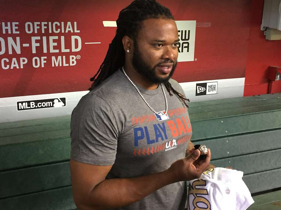 Johnny Cueto of the San Francisco Giants shows off his World Series ring after receiving it from a Kansas City Royals representative at Chase Field in Phoenix on May 14, 2016. Photo: John Shea