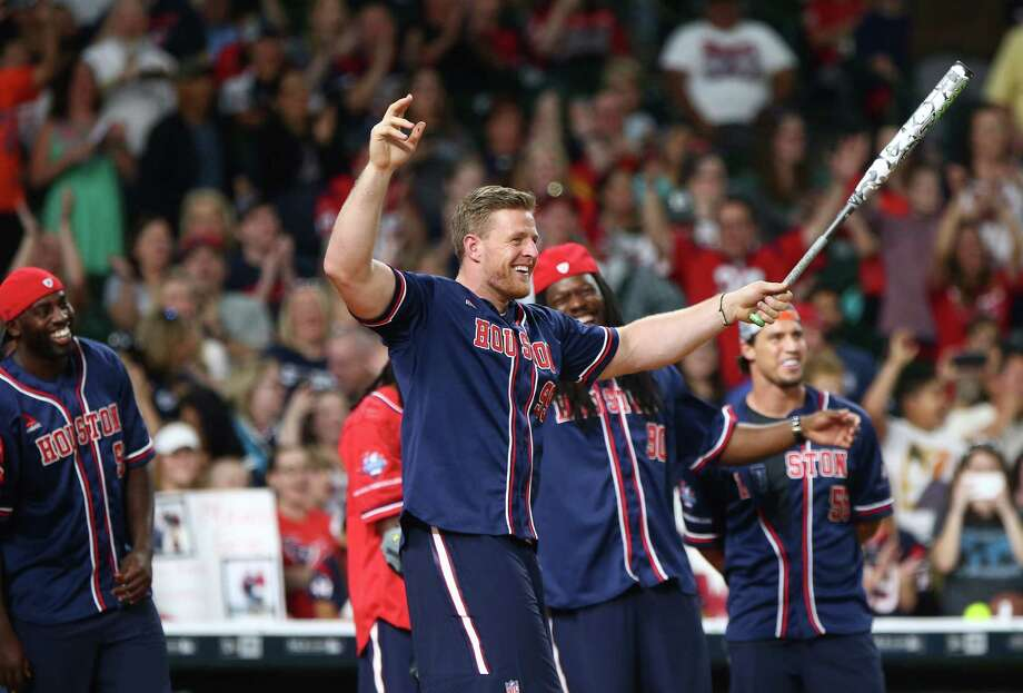Houston Texans defensive end J.J. Watt (99) celebrates after hitting a home run on a pitch from Roger Clemens before the 4th annual J. J. Watt Charity Classic at Minute Maid Park Saturday, May 14, 2016, in Houston. Photo: Jon Shapley, Houston Chronicle / © 2015  Houston Chronicle