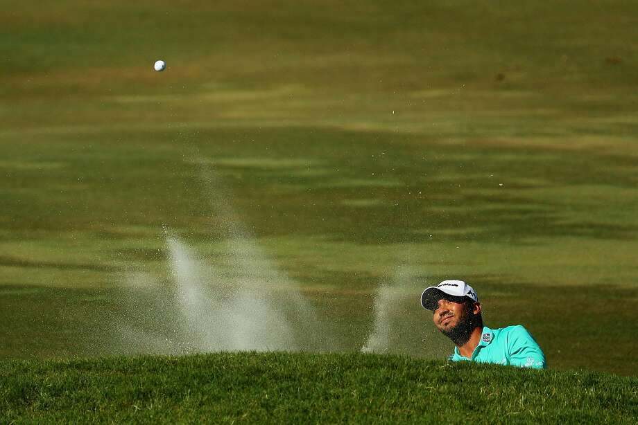 Jason Day keeps his head above the sand, playing out of a bunker on the 11th hole at The Players Championship. Photo: Mike Ehrmann, Getty Images