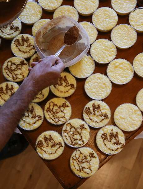 Rice pudding is topped with a cinnamon design. Photo: Michael Macor, The Chronicle
