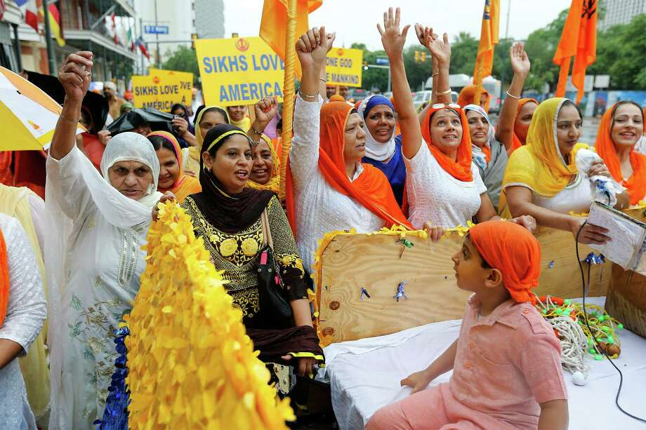 Dev Singh, 4, sits on a float as women of the Sikh community take part in its March for Peace downtown. A crowd that organizers estimated to be about 500 also gathered at Maverick Plaza for food, prayer and demonstrations of a South Asian martial art. Photo: Photos By Kin Man Hui /San Antonio Express-News / ©2016 San Antonio Express-News