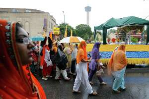"""The Sikh community from across the state gathered for a march in downtown San Antonio on Saturday, May 14, 2016. According to officials at the event about 1,000 Sikhs gathered for food, fellowship, worship and public awareness. Despite a burst of rain showers prior to the start of the march, organizers and participants still went ahead with the event. """"We want people to know that the Sikh community shares those American values of equality and justice for all,"""" said Simran Kaur of the Sikh Center of San Antonio. """"The majority of the people you see wearing turbans are actually Sikh Americans and the turban represents the tenants of our faith which are justice for all and equality. Our community is very open and willing to engage. Our house of worship is open to all,"""" Kaur said. This year marks nearly 10 years that the local Sikh community has held a march for public awareness according to Kaur. (Kin Man Hui/San Antonio Express-News)"""