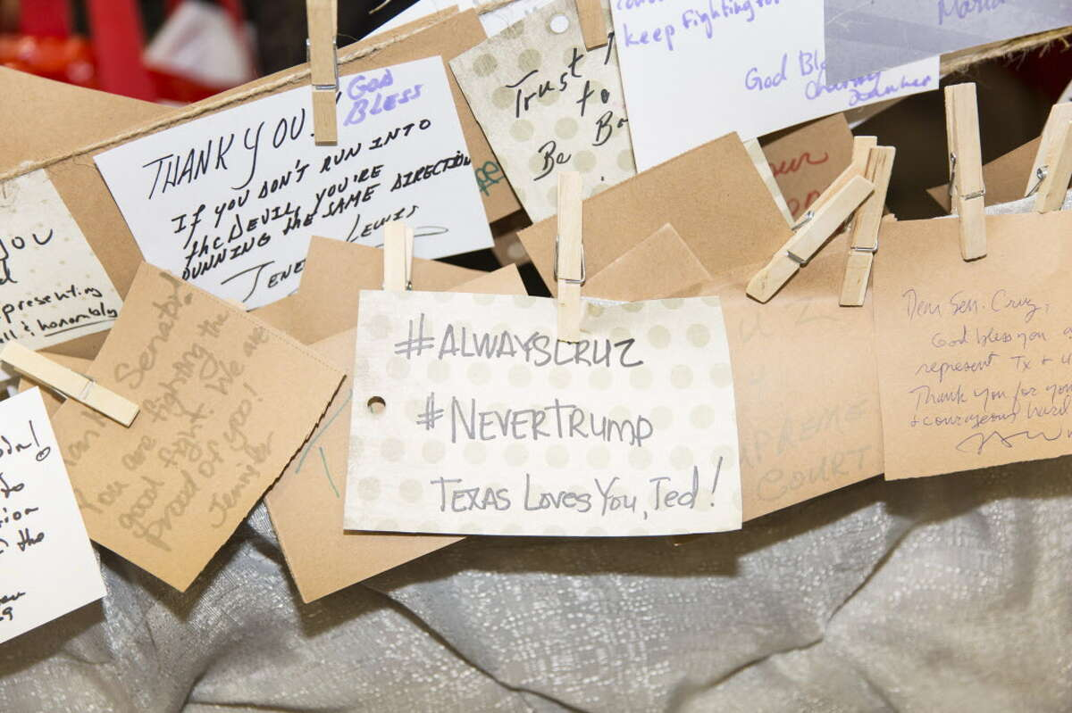 Messages of support for Senator Ted Cruz, a Republican from Texas and former 2016 presidential candidate, hang at the Cruz campaign booth during the 2016 Texas Republican Convention in Dallas, Texas, U.S., on Saturday, May 14, 2016. Paul Ryan made clear Thursday that he is sticking with his extraordinary gambit that he isn't ready to support the Republican nominee for president unless Donald Trump can demonstrate that he's Republican enough. Photographer: Laura Buckman/Bloomberg