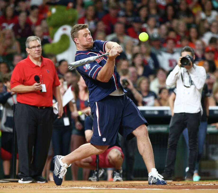 Houston Texans defensive end J.J. Watt (99) bats during a homerun derby before the 4th annual J. J. Watt Charity Classic at Minute Maid Park Saturday, May 14, 2016, in Houston. Photo: Jon Shapley, Houston Chronicle / © 2015  Houston Chronicle