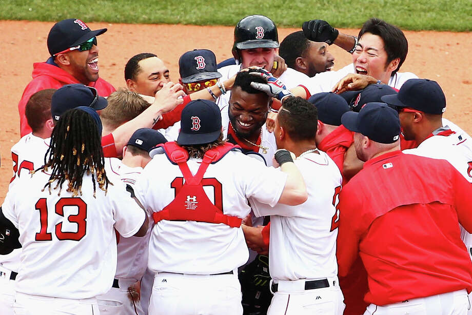 With Astros center fielder Jake Marisnick unable to corral David Ortiz's 11th-inning drive, left, the 40-year veteran, center at right, walked off a hero at Fenway Park. Photo: Maddie Meyer, Staff / 2016 Getty Images