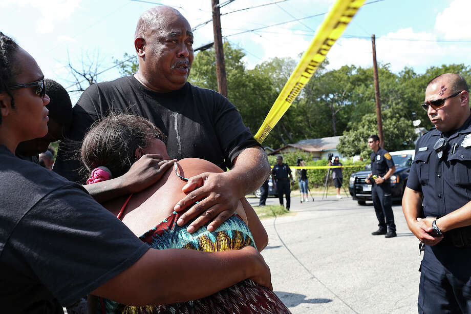 Joseph Trusty and Olivia Fenner, the parents of Tru Trusty, 16, grieve at the scene where a young man was shot and killed, who they believe to be Trusty, in San Antonio on Saturday, Sept. 26, 2015. They pleaded to the police for confirmation of the victim's identity but authorities would not confirm it was Trusty and they were told to call the Medical Examiner's office Sunday morning. Photo: Lisa Krantz, San Antonio Express-News / San Antonio Express-News / ©2015 San Antonio Express-News