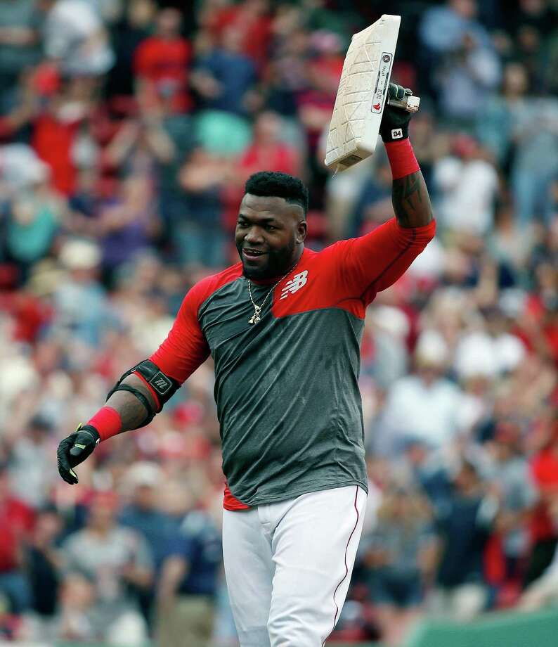 Boston Red Sox's David Ortiz holds up second base after hitting the game-winning RBI double during the 11th inning of a baseball game against the Houston Astros in Boston, Saturday, May 14, 2016. The Red Sox won 6-5. (AP Photo/Michael Dwyer) ORG XMIT: MAMD115 Photo: Michael Dwyer / Copyright 2016 The Associated Press. All rights reserved. This m