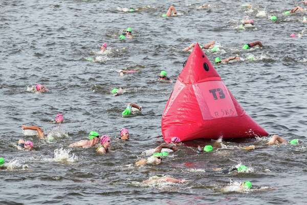 Athletes circled around a buoy in Lake Woodlands during the swim segment for this year's Ironman North American Championship Texas triathon.