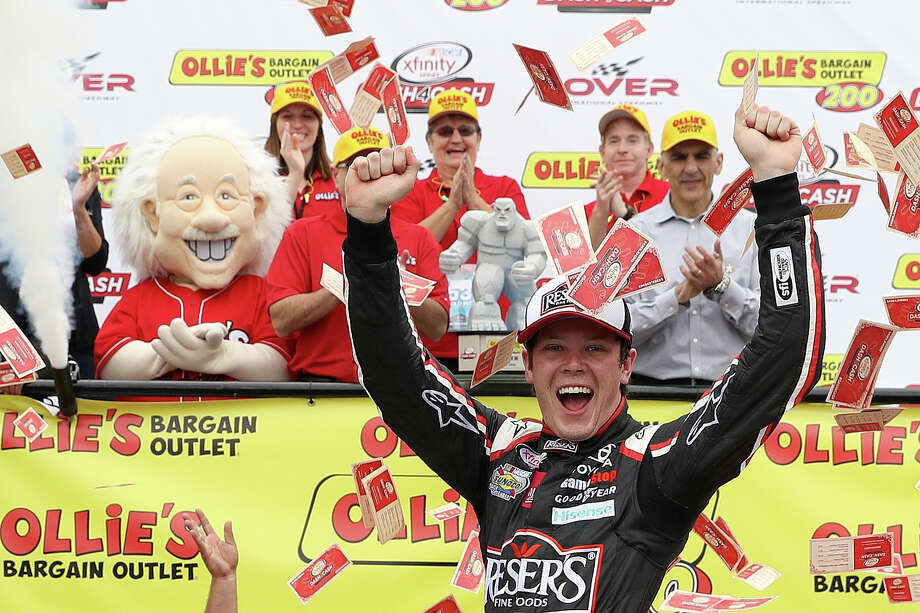 DOVER, DE - MAY 14:  Erik Jones, driver of the #20 Reser's Fine Foods Toyota, celebrates in Victory Lane after winning the NASCAR XFINITY Series Ollie's Bargain Outlet 200 at Dover International Speedway on May 14, 2016 in Dover, Delaware.  (Photo by Patrick Smith/Getty Images) ORG XMIT: 639296393 Photo: Patrick Smith / 2016 Getty Images