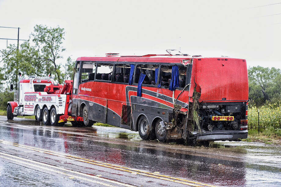 A charter bus carrying about 50 passengers rolled over Saturday, May 14, 2016 on North U.S. 83 in Webb County. Seven people died at the scene, authorities said. Photo: Danny Zaragoza / Laredo Morning Times