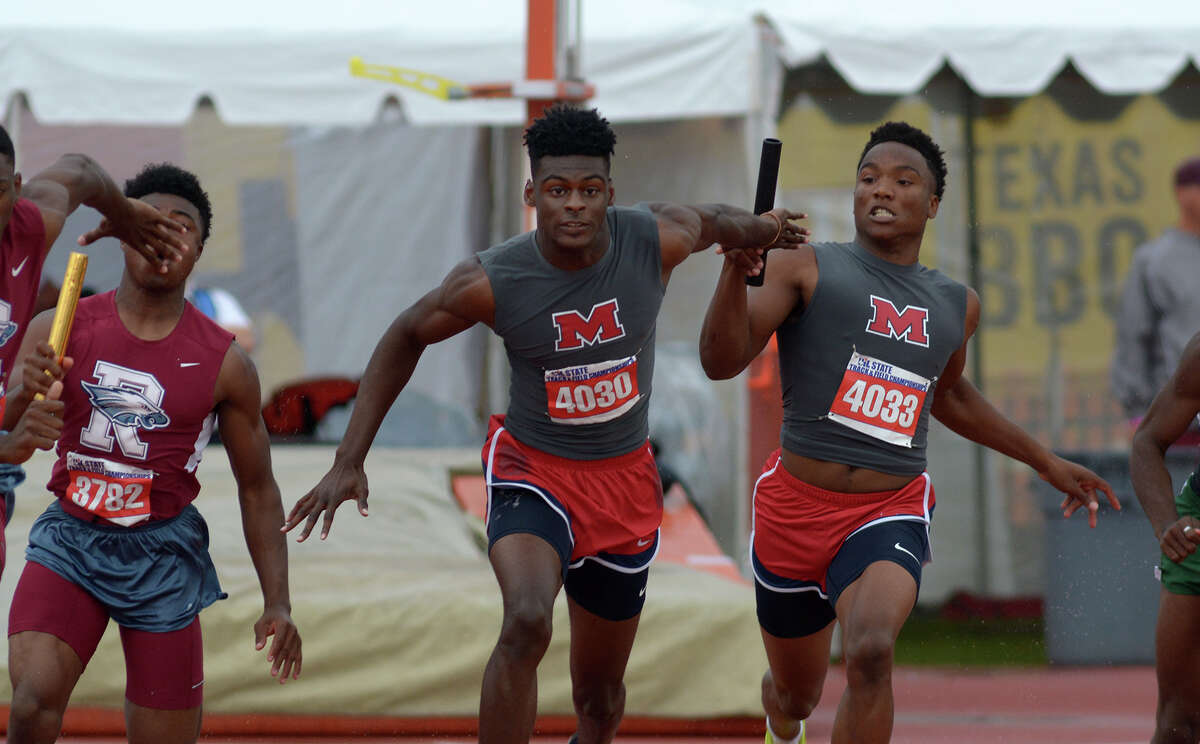Manvel's Daniel Ford (4030) takes the baton from teammate D'Eriq King (4033) during the Conference 6A Boys 400 Meter Relay at the UIL Track & Field Championships at Mike R. Meyers Stadium on the campus of The University of Texas at Austin on Saturday, May 14, 2016. (Photo by Jerry Baker/Freelance)