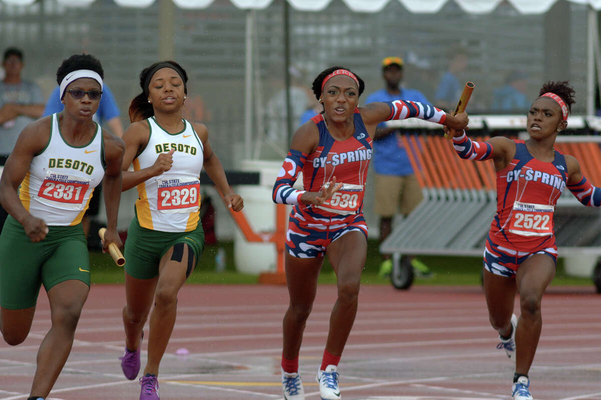 Cy-Springs' Sierra Smith, center, takes the baton from teammate Rachel Hall (2522) during the Conference 6A Girls 400 Meter Relay at the UIL Track & Field Championships at Mike R. Meyers Stadium on the campus of The University of Texas at Austin on Saturday, May 14, 2016. (Photo by Jerry Baker/Freelance)