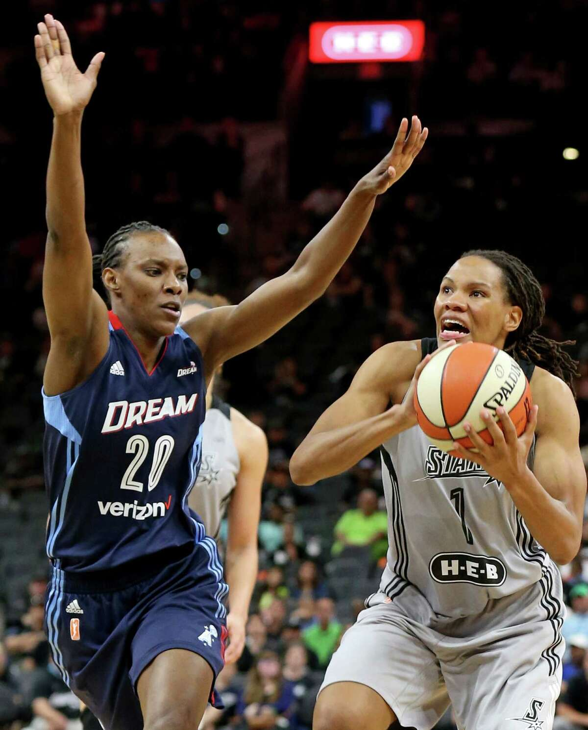 San Antonio Stars' Monique Currie shoots around Atlanta Dream's Sancho Lyttle during second half action Saturday May 14, 2016 at the AT&T Center. The Dream won in overtime 73-63.