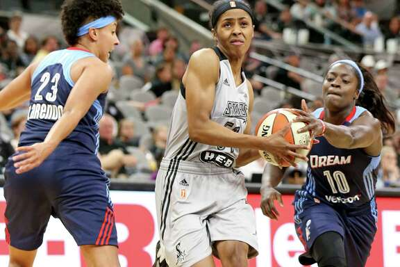 San Antonio Stars' Sydney Colson looks for room between Atlanta Dream's Layshia Clarendon (left) and Matee Ajavon during first half action on May 14, 2016 at the AT&T Center.