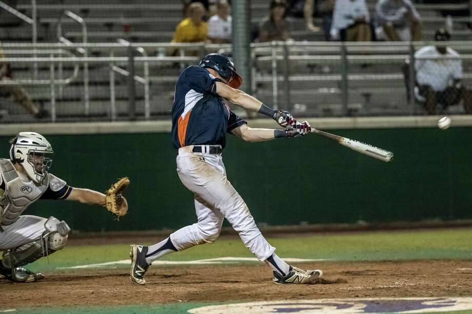 Seven Lakes Spartans outfielder Conner Capel (19) hits the game winning single during the second game of the UIL 2016 High School Baseball State Championship Second Round Playoff game between the Cypress Ranch Mustangs and the Seven Lakes Spartans at Seven Lakes High School on Saturday, May 14, 2016.  The Spartans defeated the Mustangs 7-6 in 13 innings. Photo: Tim Warner, For The Chronicle / Houston Chronicle