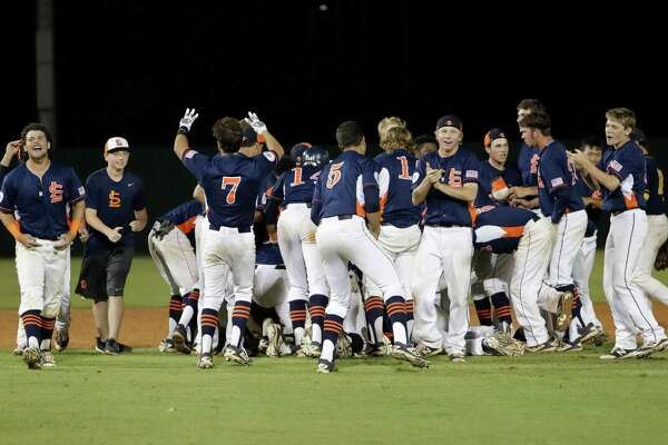 The Seven Lakes Spartans celebrate after the second game of the UIL 2016 High School Baseball State Championship Second Round Playoff game between the Cypress Ranch Mustangs and the Seven Lakes Spartans at Seven Lakes High School on Saturday, May 14, 2016.  The Spartans defeated the Mustangs 7-6 in 13 innings.