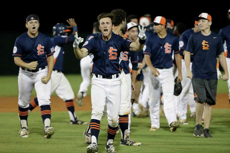 Seven Lakes Spartans infielder Zach Berry (7) and the Seven Lakes Spartans celebrate after the second game of the UIL 2016 High School Baseball State Championship Second Round Playoff game between the Cypress Ranch Mustangs and the Seven Lakes Spartans at Seven Lakes High School on Saturday, May 14, 2016.  The Spartans defeated the Mustangs 7-6 in 13 innings. Photo: Tim Warner, For The Chronicle / Houston Chronicle
