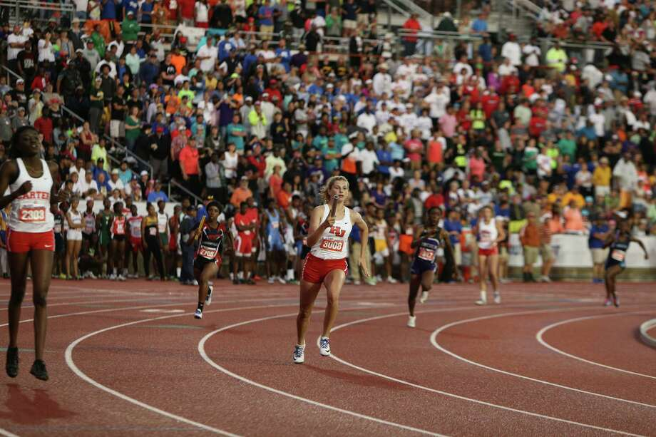 Katelyn Holland of Hardin-Jefferson High School runs a leg of the Class 4A girls 800-meter relay at the 2016 UIL State Track and Field Meet on Saturday, May 14, 2016 at Mike A. Myers Stadium on the campus of the University of Texas in Austin, Texas. The Lady Hawks team won gold in the event. Photo: Scott W. Coleman / © 2016 Scott W. Coleman, all rights reserved.