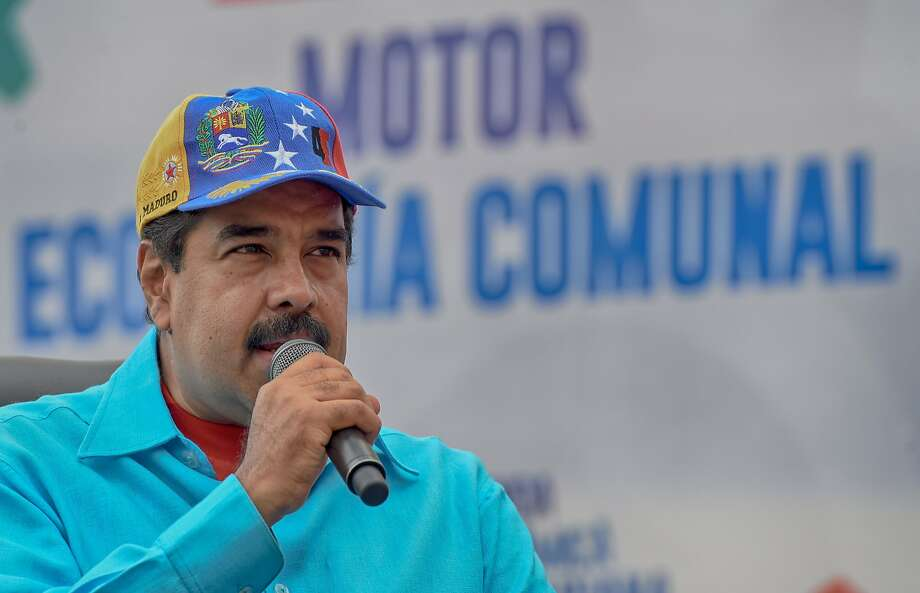 "President Nicolas Maduro accuses businesspeople of ""sabotage"" by halting production at their plants. Photo: JUAN BARRETO, AFP/Getty Images"