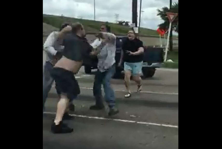 A street brawl caught on video Saturday in northwest Houston was a result of apparent road rage. Witnesses say the fight erupted after the driver of a truck did not want to let a car merge into traffic at Highway 6 near Interstate 290. Photo: David Dao