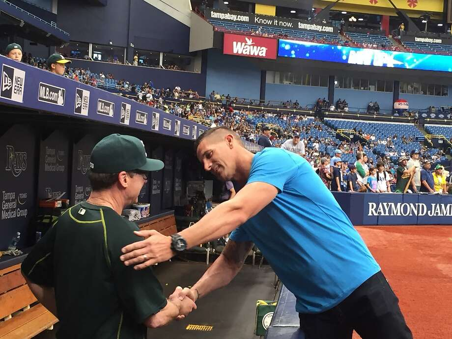 Former A's closer Grant Balfour greets Oakland manager Bob Melvin before throwing out the first pitch Sunday at Tropicana Field. Photo: Susan Slusser/The Chronicle