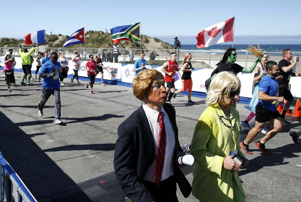 """Donald Trump"" and ""Hillary Clinton"" run the Bay to Breakers race in San Francisco, California, on Sunday, May 15, 2016. Photo: Connor Radnovich / San Francisco Chronicle"