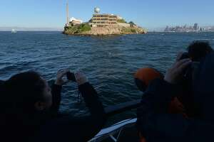 Visitors take photos while on the boat heading to the Alcatraz Night Tour on Alcatraz Island on Alcatraz Island on March 31, 2016. The night tour takes a few hundred visitors on activities not offered during the day. (Doug Duran/Bay Area News Group/TNS)