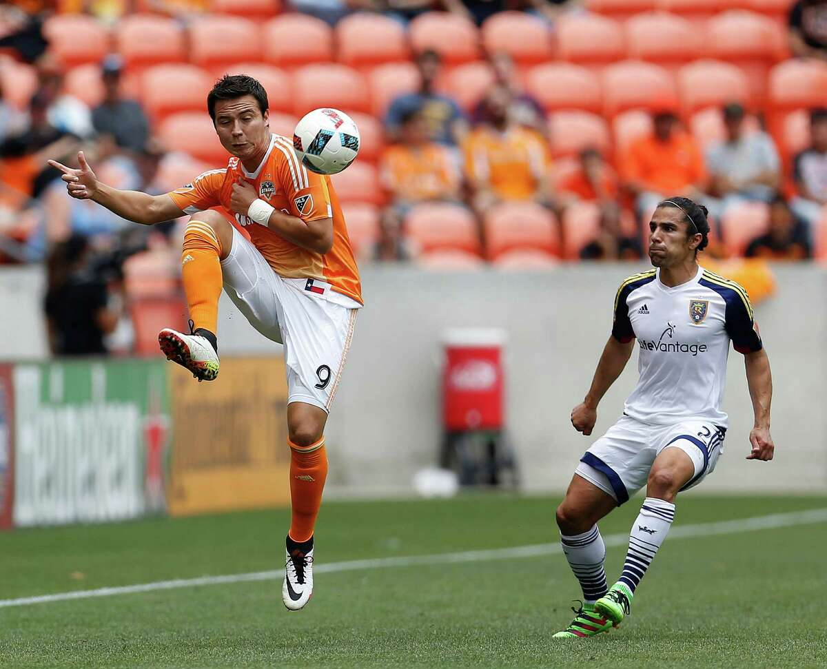 Houston Dynamo forward Erick Torres (9) drives the ball during the first half of an MLB soccer game at BBVA Compass Stadium, Sunday, May 15, 2016, in Houston.