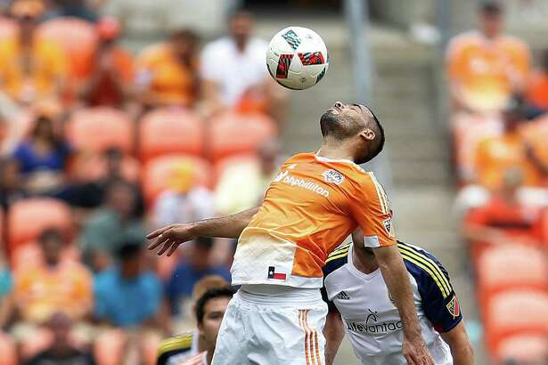 Houston Dynamo midfielder Alex (14) goes up for the ball during the first half of an MLB soccer game at BBVA Compass Stadium, Sunday, May 15, 2016, in Houston.