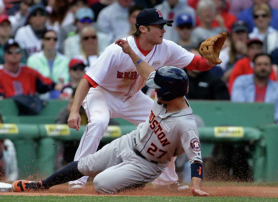 Houston Astros' Jose Altuve (27) slides safely into third base as Boston Red Sox's Josh Rutledge, top, waits for the ball in the fifth inning of a baseball game at Fenway Park, Sunday, May 15, 2016, in Boston. (AP Photo/Steven Senne) Photo: Steven Senne, Associated Press / Copyright 2016 The Associated Press. All rights reserved. This material may not be published, broadcast, rewritten or redistribu