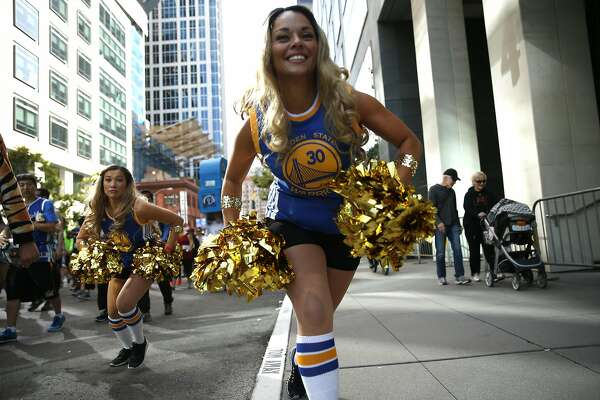 A pair of women dressed as Golden State Warriors' cheerleaders head down Howard Street during Bay to Breakers in San Francisco, Calif., on Sunday, May 15, 2016.