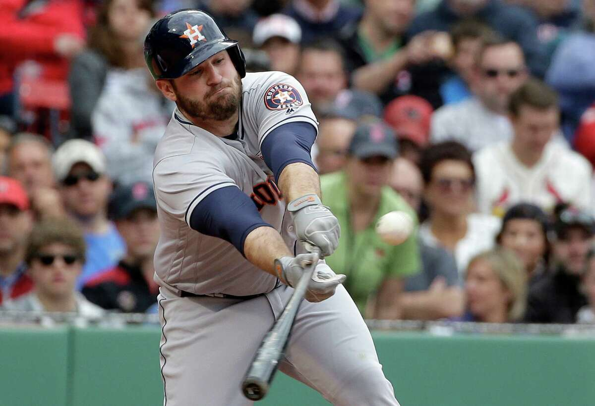 Houston Astros' Tyler White hits an RBI single off a pitch by Boston Red Sox's Robbie Ross Jr. in the sixth inning of a baseball game at Fenway Park, Sunday, May 15, 2016, in Boston. (AP Photo/Steven Senne)