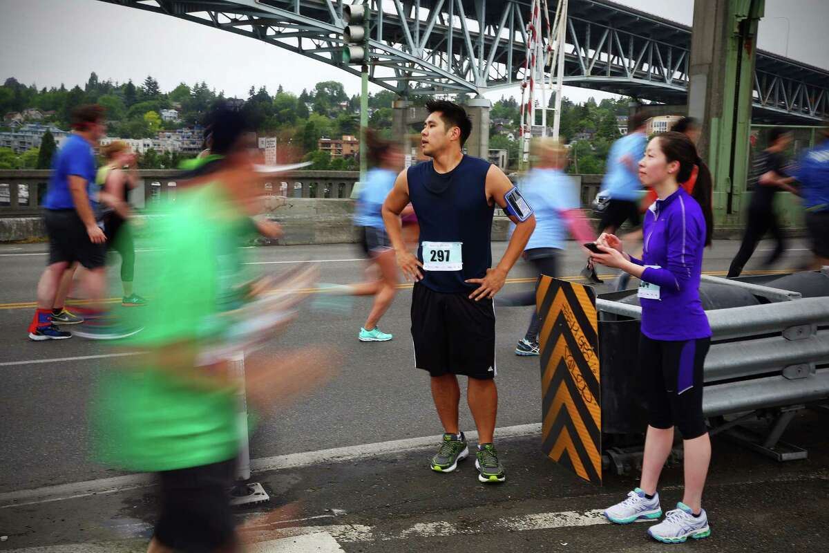 Participants run across the University Bridge in the 34th annual Beat the Bridge to Beat Diabetes race, Sunday, May 15, 2016. Thousands participated in the race and fundraising event for the Juvenile Diabetes Research Foundation that raised money for type 1 diabetes research. The event consists of an 8K run and, a 3-mile walk, a 1-mile fun run and the Diaper Derby for toddlers.