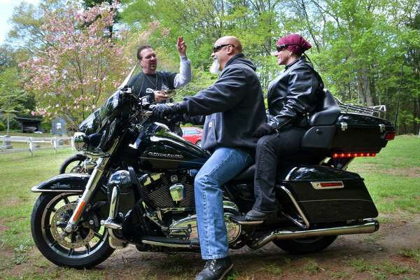 Riverside Community Church Paster, Hal Hunt, blesses motorcyclists at the start of the fifth annual Bike Blessing, Poker Run and Barbecue in Oxford, Conn. on Sunday, May 15, 2016. The ride originated when Pastor Hunt and his wife arrived at church on their motorcycles and a member of the congregation suggested a bike blessing. All proceeds from the ride go toward Homes for the Brave in Bridgeport, Conn., a nonprofit that supports veterans readjusting to the community.