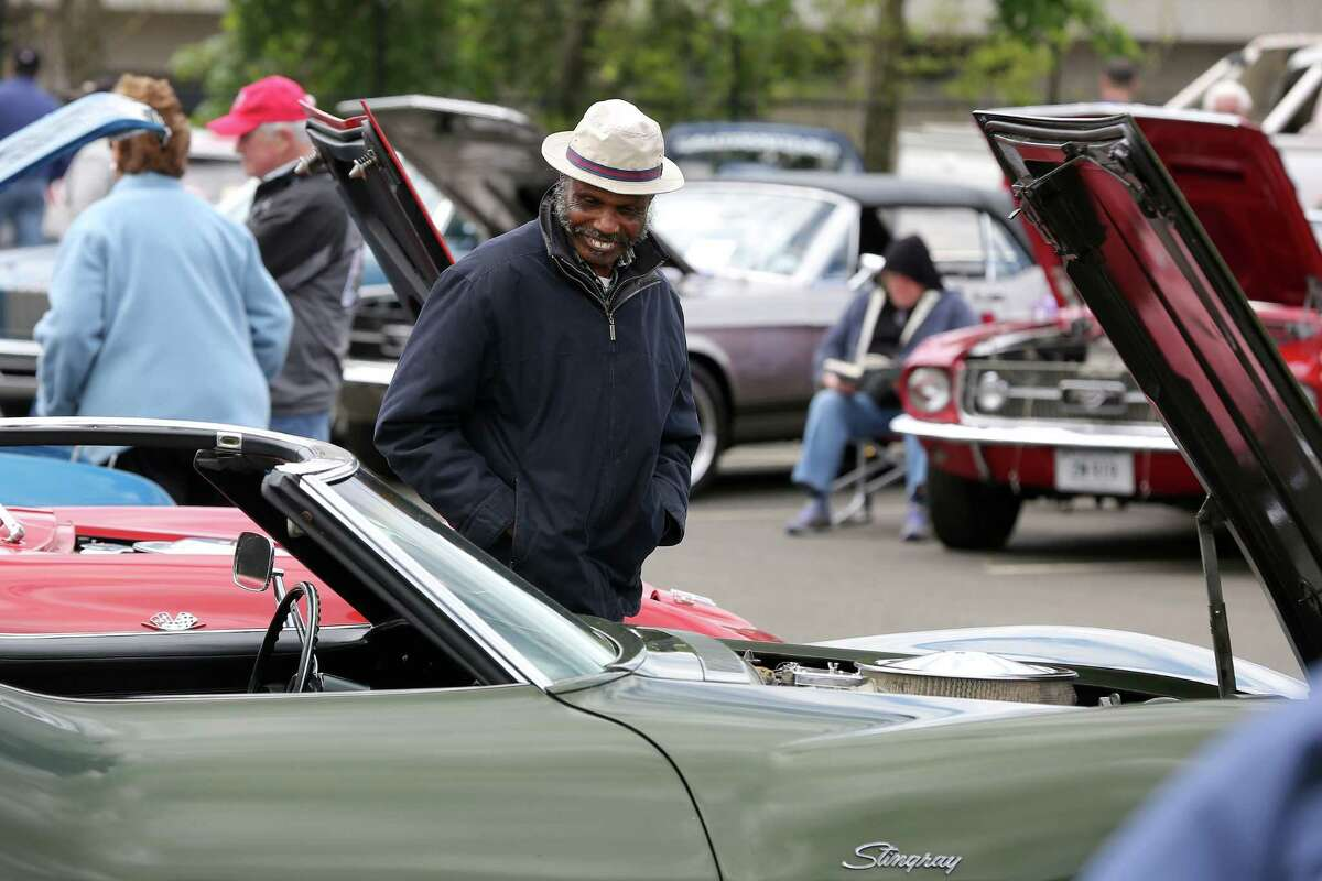 Macroy Smith, of Stamford, looks into at interior of an old Stingray during the car show.