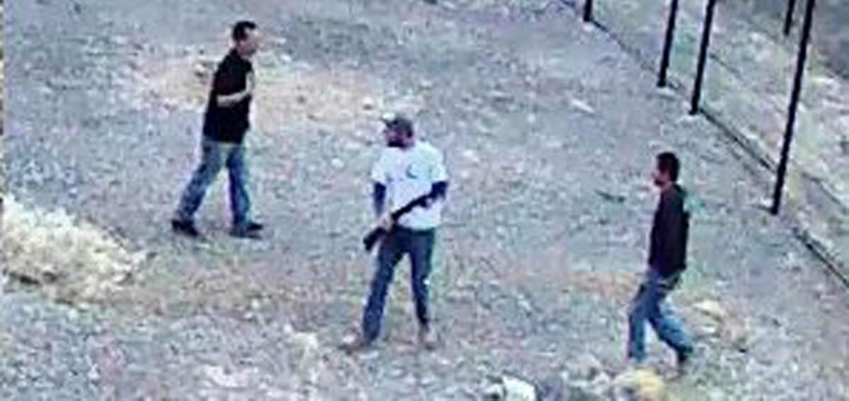 When 'Merica goes out ... In this Saturday, April 30, 2016, file photo, a still image taken from security video released by the National Park Service, shows three men inside the perimeter fence at the edge of Devils Hole, in Death Valley National Park, Nev. The National Park Service says the men climbed a fence guarding Devils Hole, a detached portion of the park located in southwestern Nevada, on April 30. The Park Service says they fired a shotgun at least 10 times and one man swam in Devils Hole, a hot-water pool that is the only natural home of the tiny Devils Hole pupfish. The man left his boxer shorts in the water. (National Park Service via AP, File) Story: Guns, beer and vomit: Rampage leaves endangered fish dead in Death Valley