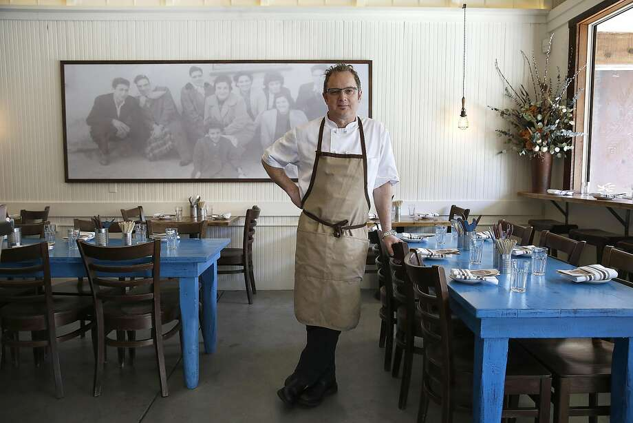 Manuel Azevedo at his newest restaurant, Tasca Tasca in Sonoma. The dining room includes photos of his family, who immigrated from Portugal. Photo: Liz Hafalia, The Chronicle