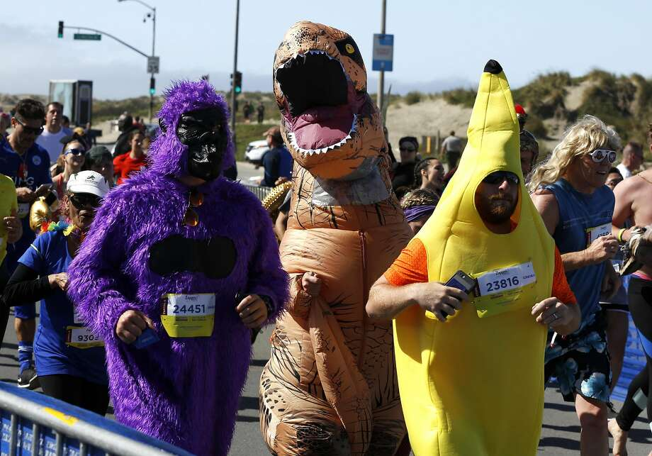 A purple gorilla, t-rex and yellow banana run the Bay to Breakers race in San Francisco on Sunday, May 15, 2016. Photo: Connor Radnovich, The Chronicle