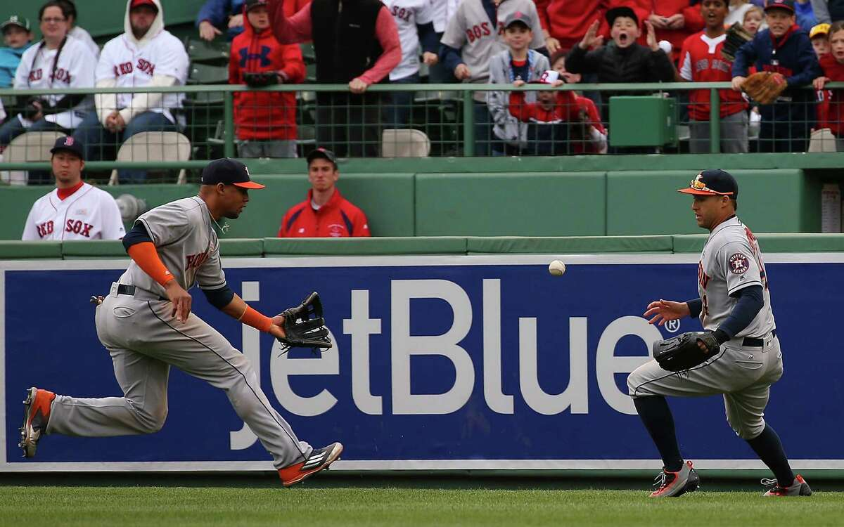 BOSTON, MA - MAY 15: Carlos Gomez #30 of the Houston Astros and George Springer #4 are unable to catch a ball hit by Ryan Hanigan #10 of the Boston Red Sox, which allowed a run to score, in the seventh inning at Fenway Park on May 15, 2016 in Boston, Massachusetts.