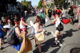 A pillow fight breaks out on Howard Street dur ing the Bay to Breakers race in San Francisco.