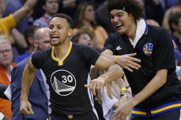 Golden State Warriors guard Stephen Curry (30) celebrates with teammate Anderson Varejao, right, after hitting the game-winning shot in overtime of an NBA basketball game against the Oklahoma City Thunder in Oklahoma City, Saturday, Feb. 27, 2016. Golden State won 121-118. (AP Photo/Sue Ogrocki)
