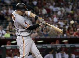 San Francisco Giants' Trevor Brown hits a solo home run against the Arizona Diamondbacks during the third inning of a baseball game, Sunday, May 15, 2016, in Phoenix. (AP Photo/Matt York)