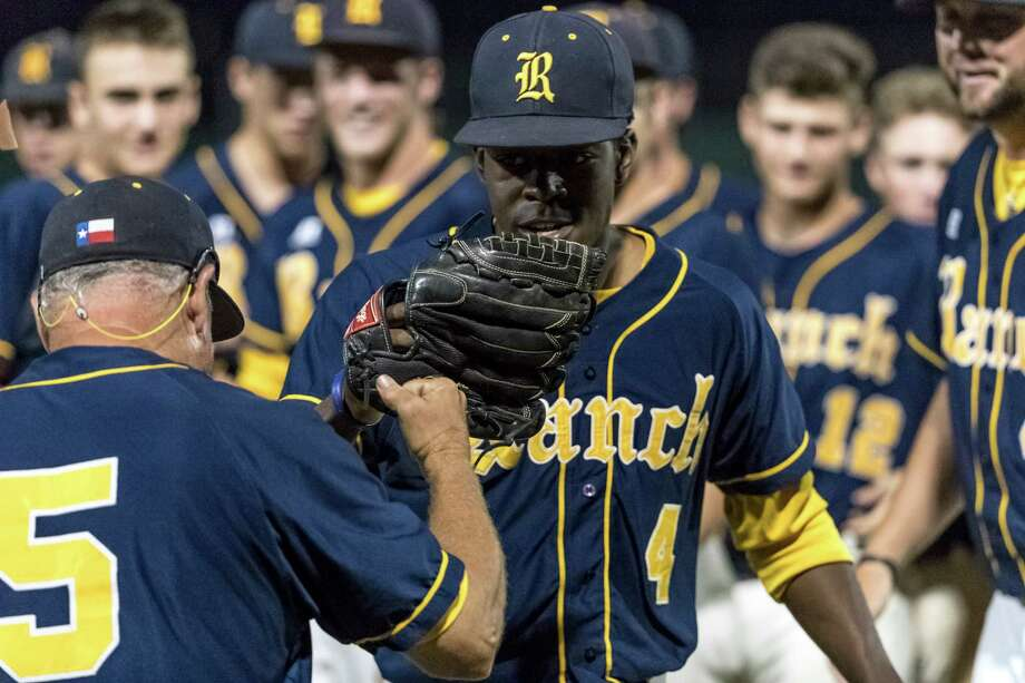 Cypress Ranch Mustangs pitcher Sidney McWhite (4) gets a fist bump from Cypress Ranch Mustangs head coach John Pope during the third game of the UIL 2016 High School Baseball State Championship Second Round Playoff game between the Cypress Ranch Mustangs and the Seven Lakes Spartans at Seven Lakes High School on Saturday, May 14 and Sunday, May 15, 2016.  The Mustangs defeated the Spartans 9-0. Photo: Tim Warner, For The Chronicle / Houston Chronicle