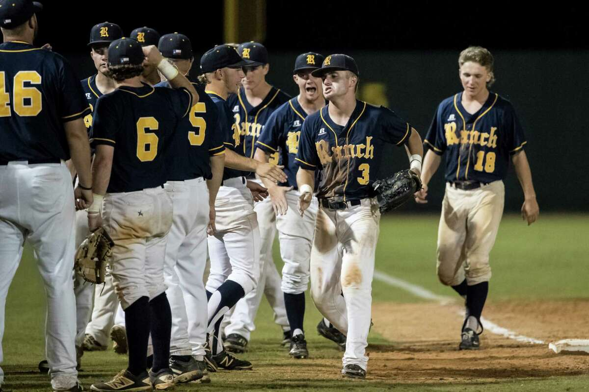 Cypress Ranch Mustangs center fielder Eric Bonhert (3) is greeted by teammates after making a play in the outfield during the third game of the UIL 2016 High School Baseball State Championship Second Round Playoff game between the Cypress Ranch Mustangs and the Seven Lakes Spartans at Seven Lakes High School on Saturday, May 14 and Sunday, May 15, 2016. The Mustangs defeated the Spartans 9-0.
